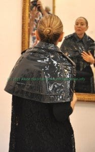 woman gazing into the mirror at Imitation of Christ fashion show