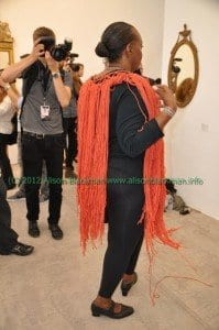 model with orange fringe at Imitation of Christ fashion show
