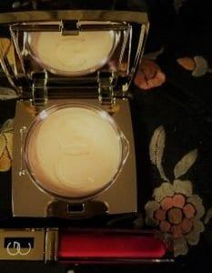 gerard cosmetics compact and lip gloss on print fabric