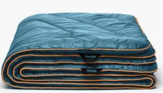 holiday gift idea rumpl original puffy blanket in blue stock photo from RUMPL