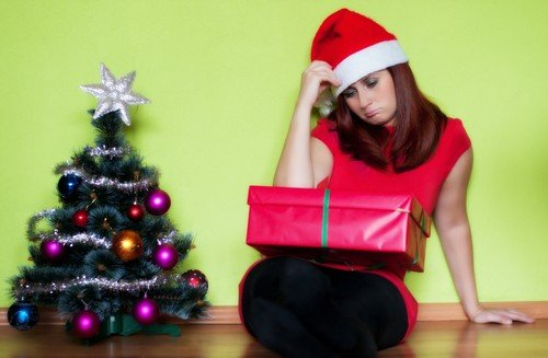shutterstock Royalty-free stock photo ID: 155208512 Sad young woman alone in Christmas time