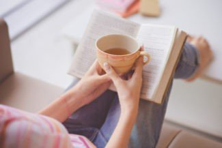 g books reading with coffee cup By Dragon Images
